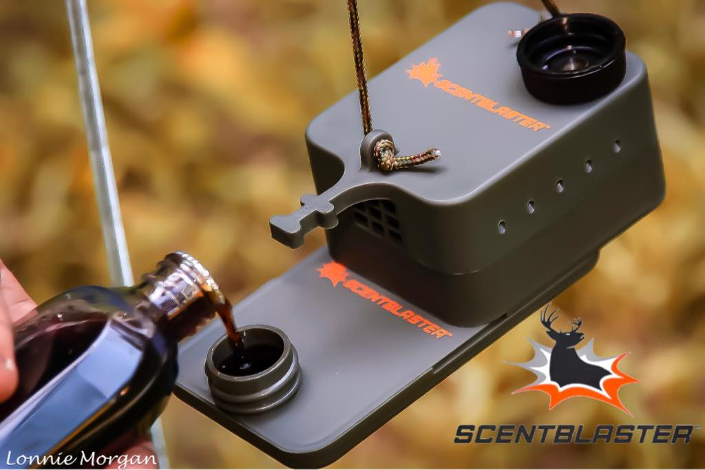 Pouring scent into a ScentBlaster, the #1 hunting scent dispenser
