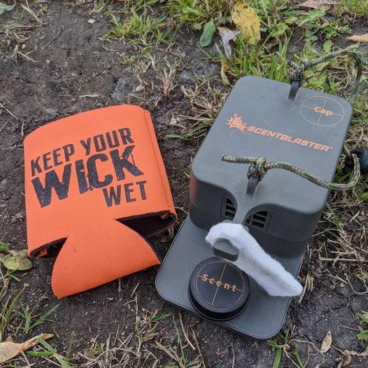 Keep Your Wick Wet Koozie and ScentBlaster on the ground