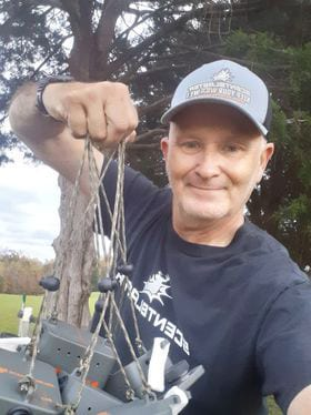 Man holding 6 Scentblasters ready to hang for his upcoming hunt.